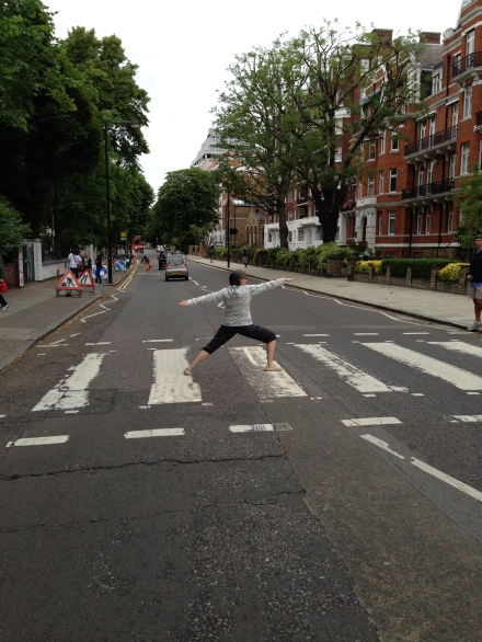 Yoga instructor Katherine poses on Abby Road in London
